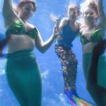 Girl with rare condition gets wish to swim with mermaids