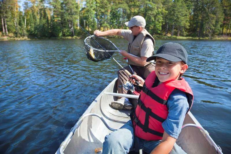 boy-and-father-fishing-in-a-canoe