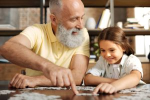 Grandfather doing a puzzle with child