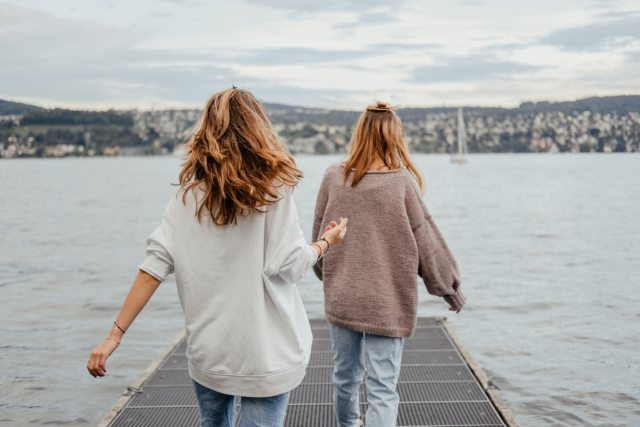 two women, friends, walking, lake