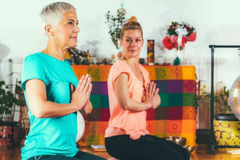 senior-woman-on-private-yoga-class