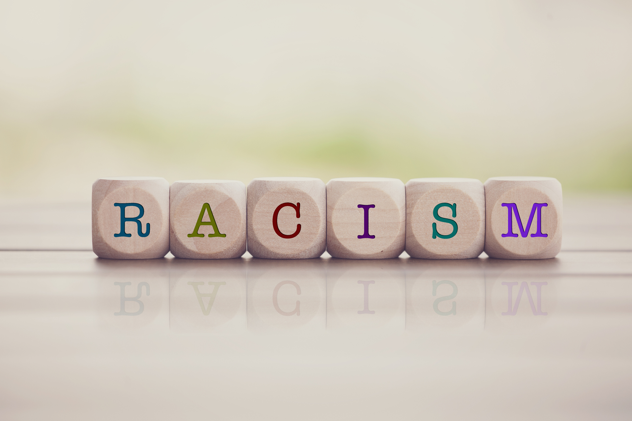 The word racism spelled out on cube blocks